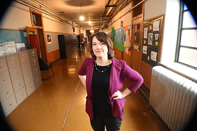 Rhonda Taylor, the OKC Public School system's director of fine arts, in the 4th floor, dimly lit hallway outside her office at the OKCPS Aministration Building.  mh