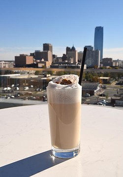 On of the O Bar's new seasonal coctails, the Sorghum Fizz, from the 7th floor patio with the Downtown OKC Skyline, 11-12-15. - MARK HANCOCK