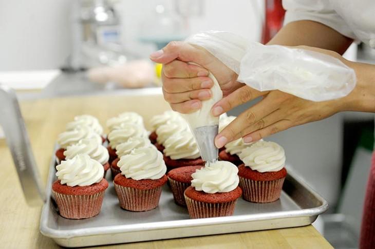 Ashleigh Barnett makes red velvet cupcakes at Crimson & Whipped Cream in Norman, Tuesday, July 21, 2015. - GARETT FISBECK