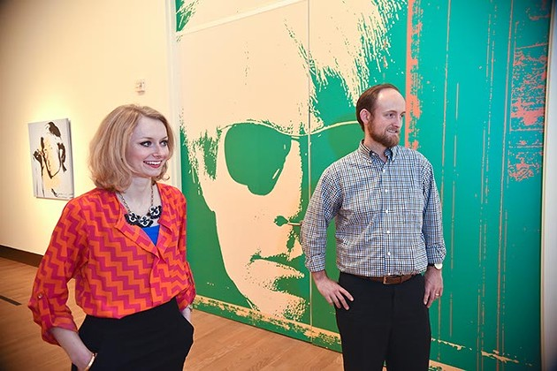 Kate Cunningham, a member of the Moderns OKCMOA group, admires works by Andy Warhol, part of The Athletes exhibit, next to Matthew Craig, a development assistant with the museum and liaison between the museum and the Moderns group, at the OKCMOA recently.  mh