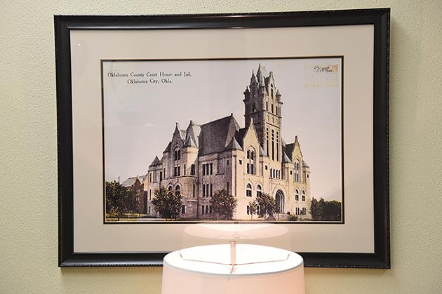 A postcard with an image of the original Oklahoma County Courthouse and Jail, hangs inside the County Office Building in the Engineering Department. (Mark Hancock)