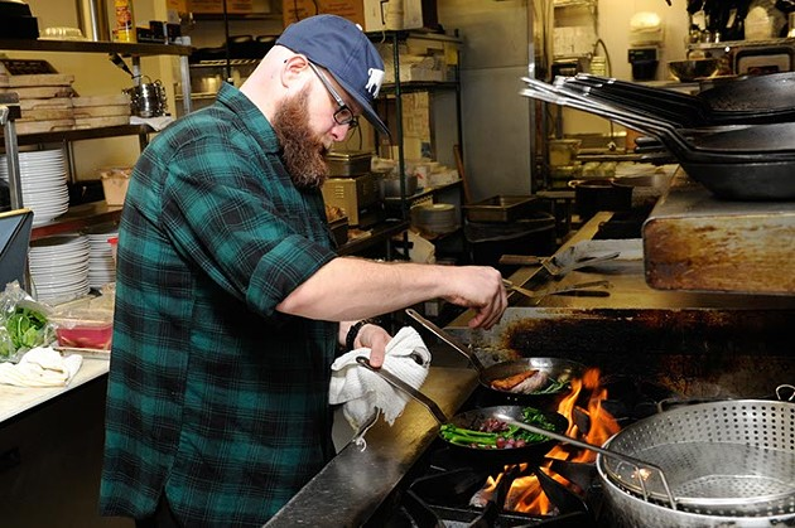 Chris McKenna, head chef, cooks at Packard's in Oklahoma City, Thursday, Dec. 24, 2015. - GARETT FISBECK