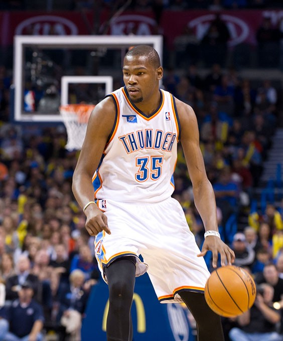 Kevin Durant sees an opening before scoring a basket against the Phoenix Suns in December duriing a home game.Photo/Shannon Cornman - SHANNON CORNMAN