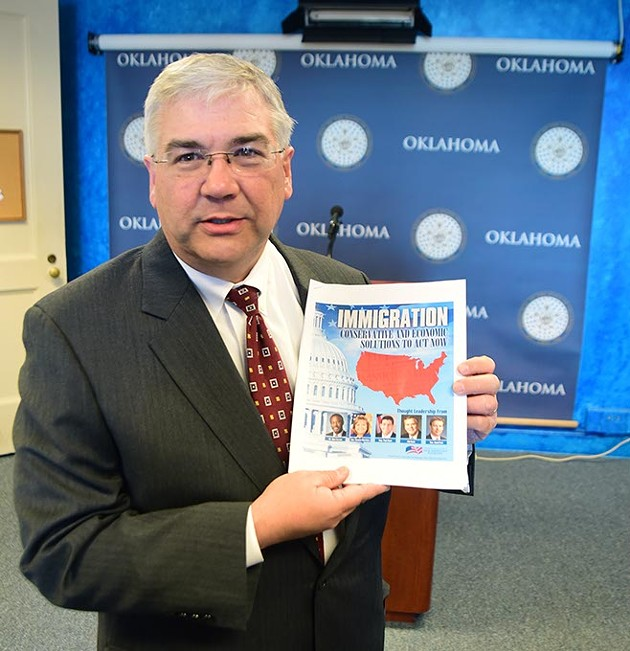 Senator Brian Cain before the start of a press conference calling for immigration reform legislation with a 16 page hand-out. (Mark Hancock)