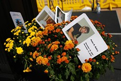 Flower arrangements with cards in memory of people who have died of perscription drug overdose during an International Overdose Awareness Day rally at the Oklahoma State Capitol in Oklahoma City, Monday, Aug. 31, 2015. - GARETT FISBECK
