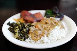 Crawfish ettouffee, collard greens, blackened pork chop, candied yams, at Cajun King in Oklahoma City, Monday, Dec. 14, 2015. - GARETT FISBECK