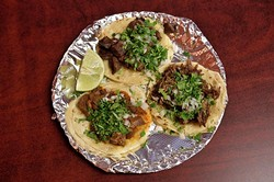 Barbacoa, carnitas and lengua tacos at Taqueria la Tropicana, 12-21-15. - MARK HANCOCK