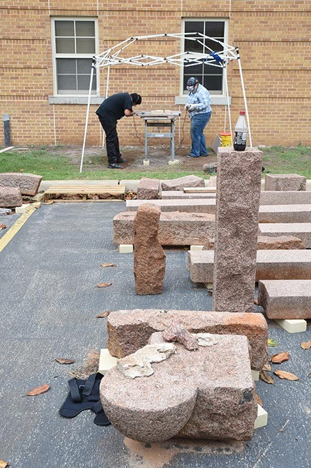 Art students grind blocks of granite, creating elements for the Coming Together Park sculpture being installed on the USAO campus.5-20-15.  mh