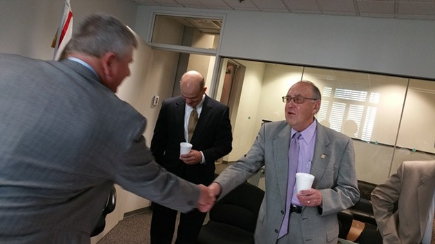 Councilman Pat Ryan, right, retires this month after a 10-year tenure on the OKC council. - BEN FELDER