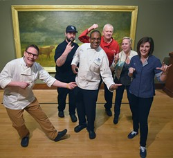 """Guest Chefs, from left, Michael Haddad, a local chef, Henry Boudreaux, of the Museum Cafe, Gayland Toriello, Ember restaurant in the Waterford Hotel, Frank Newcomb, a local chef, Allison Dake, Brown Egg Bakery, and Rachel Cope, Empire Slice House, will participate in this year's Annual Omelette Party, March 4th, with the theme """"Eggs, Drinks & Rock 'n' Roll, to benifit the OKCMOA.  Pictured in front of museum collection art """"The Coming Storm"""" by George Inness, 2-12-16, at the OKCMOA in Downtown Oklahoma City. - MARK HANCOCK"""