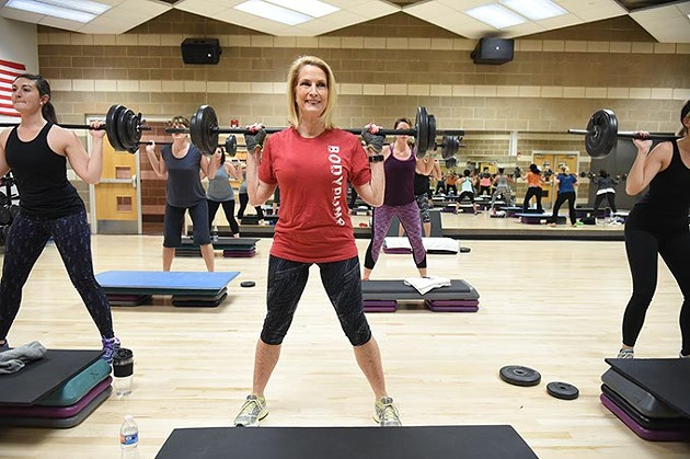 Michele Taylor, executive director for the Downtown, Mains Street, and MidTown YMCAs, lifts weights in a class at the Downtown YMCA, 1-7-16. - MARK HANCOCK