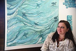 """Chickasaw artist Cale Chadwick with her work """"Ouzels Flying Through Water"""", with more of her work currently at Exhibit C.  mh"""