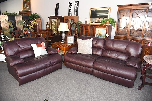 Leather half chair and sofa, at Design to Consign, on North May Avenue in OKC, 11-11-15. - MARK HANCOCK