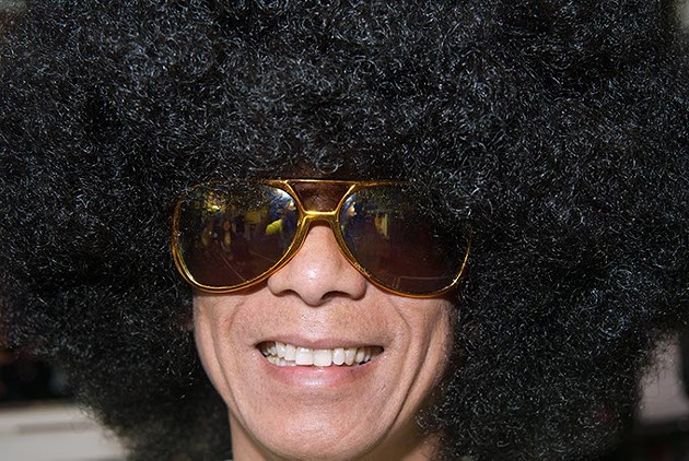 Employee Hoang Nguyen rocks the afro and a big smile at Masquerade (Mark Hancock)