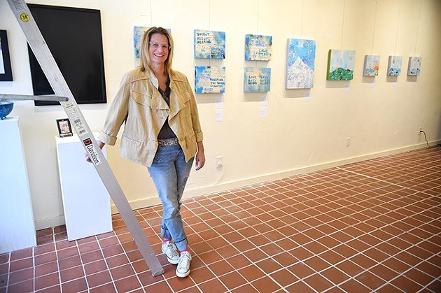 The Project Box Paseo gallery owner, Lisa Jean Allswede with new art by poet artist Kerri Shadid ready for the First Friday Gallery Art Walk on The Paseo, 10-1-15. - MARK HANCOCK