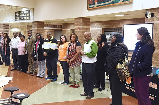 """People participate in an exercise to illustrate """"Students left behind"""" while attending The Great Conversation public meeting held at Fredrick A. Douglass High School, Monday, 3-2-15.  mh"""