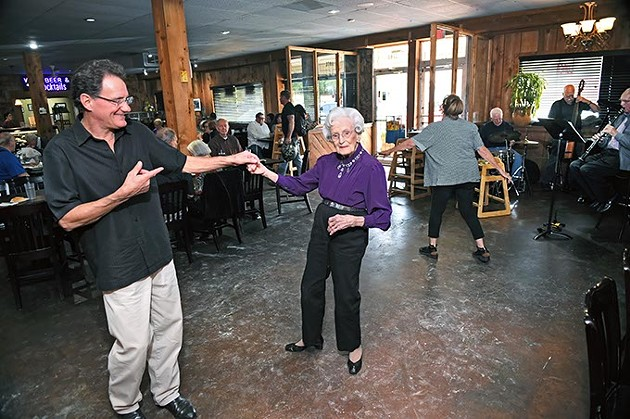George Camp and Ellen Wheeler dance during a performance at Ingrid's Kitchen by the band The Silvertops, 10-17-15. - MARK HANCOCK