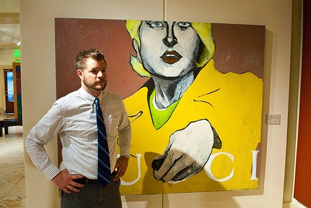 """Joel Gavin of the Oklahoma State Arts Council with """"A Mercedes is for People Like Us"""", by W. Bennett Berry, at the Oklahoma State Art Collection gallery, first floor of the State Capitol.  mh"""