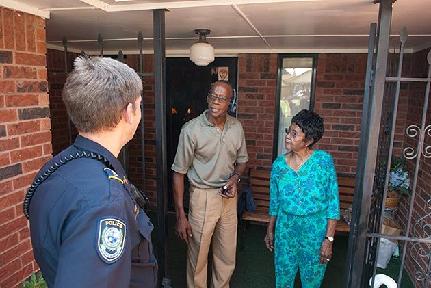 """Midwest City Police Department Community Action Officer Roland """"Rollie"""" Branham, speaks with with 86 year old Cora Rolison at her home next  Randolph Grayson a neighbor who lives across the street, recently in MWC.   mh"""
