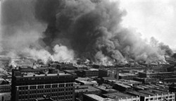 """2006.75.01 Says on back - Burning of """"Little Africa"""" the negro sction of Tulsa, OK during the race riot, June 1, 1921.  About 30 were slain, 9 white, the balance negroes.  This picture taken from the roof of the Cosden Building, 14 stories."""