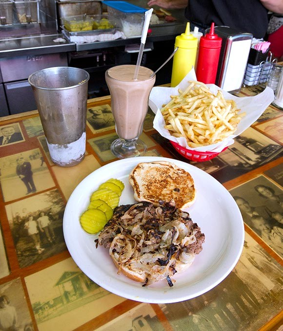 Open faced onion burger at Sid's in El Reno, Oklahoma.  File, 7-28-14. - SHANNON CORNMAN