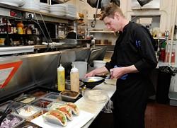 Tra Coffey makes quinoa tacos at Picasso Cafe. (Garett Fisbeck)