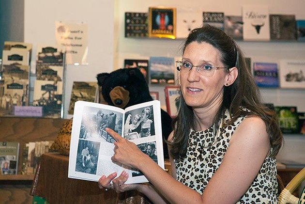 Amy Dee Stephens discusses a picture in her new Oklahoma City Zoo book, Sunday, 8-24-14, during a book signing event at Full Circle Bookstore. (Mark Hancock)
