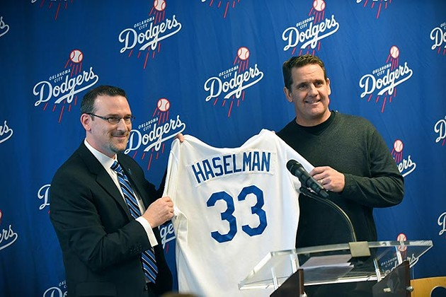 OKC Dodgers President/General Manager Michael Byrnes, presents a jersey to new manager Bill Haselman, during a welcoming press event for Haselman, at the Bricktown Ballpark, in Oklahoma City, 2-9-2016. - MARK HANCOCK