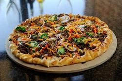 Burning pizza at Bellini's Ristorante in Oklahoma City, Monday, Feb. 1, 2016. - GARETT FISBECK