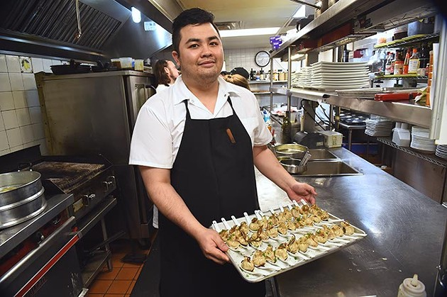 From left, Dahn Do, the last of the graduating sous chefs, with pork soup dumplings ready to serve at The Coach House, 1-25-16. - MARK HANCOCK