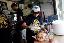Nonna prepares focaccia at the Saucee Sicilian in Oklahoma City, Wednesday, May 27, 2015. - GARETT FISBECK