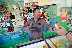 Nestor Garcia serves ice cream at his business in Oklahoma City, Thursday, April 2, 2015. - GARETT FISBECK