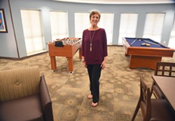 Deb Stanaland, chief support services officer, in the Game Room at the new YWCA Thelma Gaylord Emergency Shelter, 9-15-15. - MARK HANCOCK