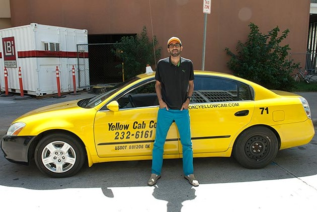 Yellow Cab driver, Abdul Nachi, poses in his waiting spot in downtown OKC. - MARK HANCOCK