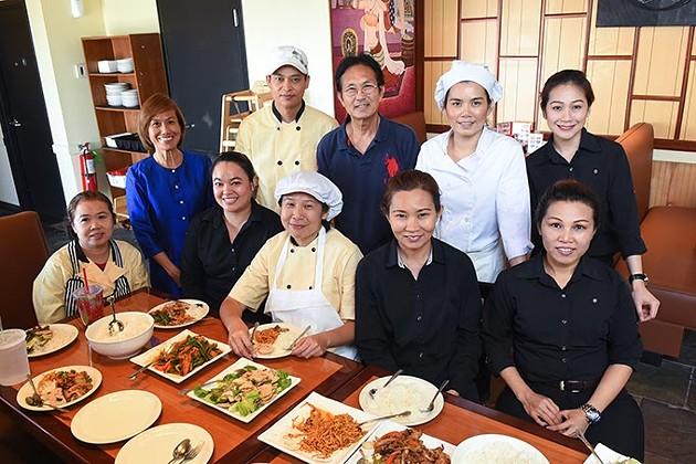 Lunchtime for the owners, 3rd and 4th from left standing, Dan Promlap and Sukanya Phansri, joining with the rest of the family which make up the crew of the new Thai Delight in Edmond.  mh