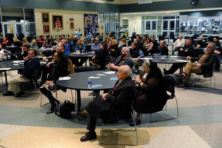 People listen during a Education Spending Accounts forum at Bishop McGuinness High School, Thursday, Jan. 21, 2016. - GARETT FISBECK