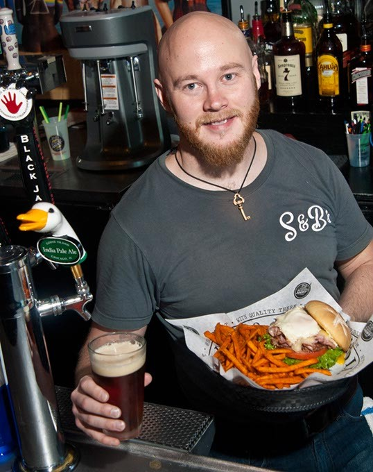 Locke Grant at the bar with the Frankenburger, sweet potatoe fries, and an Octoberfest draft beer, at S&B Burger Joint in Norman.  mh