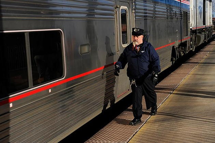 An Amtrak train prepares for departure in Oklahoma City, Friday, Feb. 13, 2015. - GARETT FISBECK
