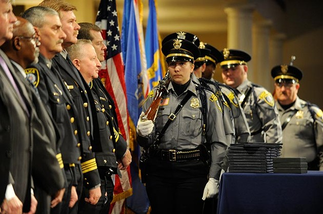 Posting of the Colors by the Oklahoma City Police Honor Guard during the Oklahoma City Police Academy Recruit Class 132 graduation at First United Methodist Church, Thursday, Dec. 4, 2014. - GARETT FISBECK