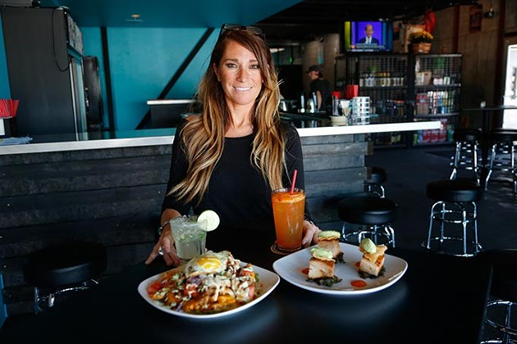 April Noriega, bartender, poses for a photo at Guyutes in Oklahoma City, Tuesday, Sept. 15, 2015. - GARETT FISBECK