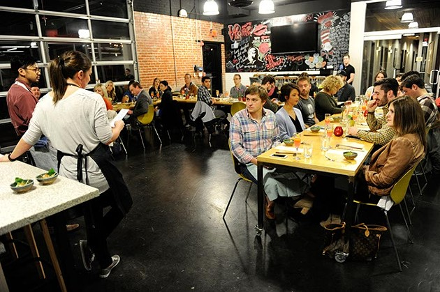 Rachel Cope and JeffChanchaleune talk to patrons during a pop-up dinner at Dunlap Codding in Oklahoma City, Tuesday, March 3, 2015. - GARETT FISBECK
