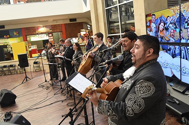 Robert Ruiz, at right, takes the lead vocal with the band Mariachi Orgullo de America, performing in the center court at Plaza Major at the Crossroads mall, Sunday afternoon.  mh