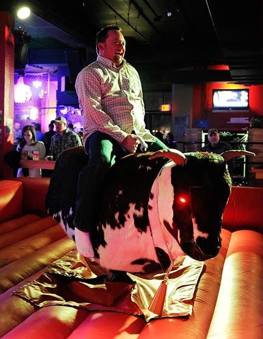 Robert Freeman rides a mechanical bull at Moonshiners in Oklahoma City, Friday, Feb. 20, 2015. - GARETT FISBECK
