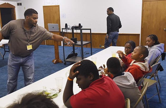 Marlon James works with boys during a group session at the Alpha Boys institute recently.  mh