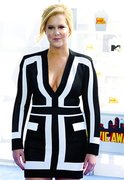 Amy Schumer at the 2015 MTV Movie Awards held at the Nokia Theatre L.A. Live in Los Angeles, USA on April 12, 2015. - BIGSTOCK