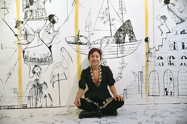 Artist Denise Duong with large, wall size artwork installation she created on panels usally researved for hanging works of art on, at JRB Art, 12-17-15. - MARK HANCOCK