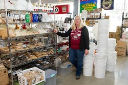 Gail White poses for a photo at the Brew Shop in Oklahoma City, Tuesday, Feb. 16, 2016. - GARETT FISBECK