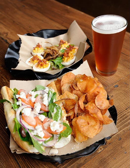Santorini Sandwich with kettle chips, deviled eggs, and Roughtail IPA at Slaughter's Hall in Oklahoma City, Wednesday, Jan. 28, 2015. - GARETT FISBECK