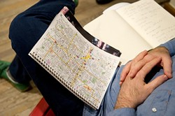 Josh Buss looks at a map of Oklahoma City while meeting with a group to discuss co-housing in Oklahoma City. (Garett Fisbeck)