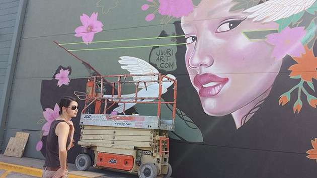 "Julie ""Juuri"" Robertson is one of several artists working on murals along Western Ave. - BEN FELDER"